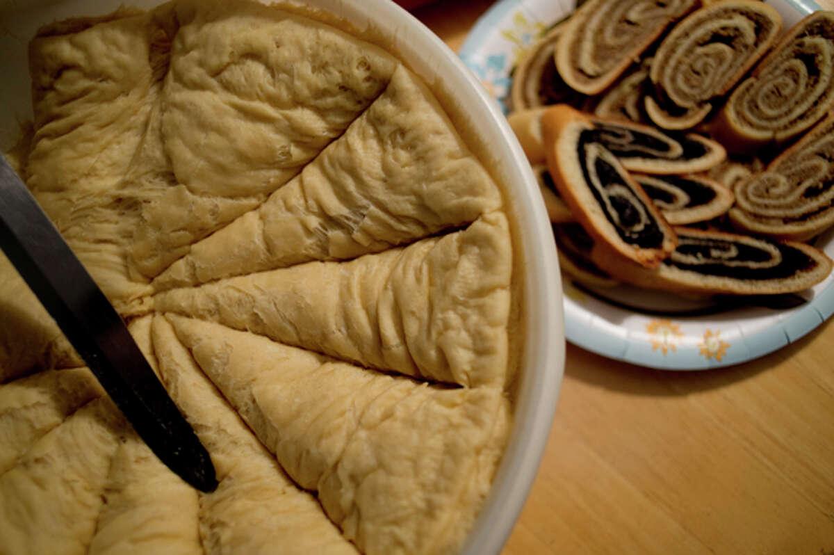 NEIL BLAKE | nblake@mdn.net Dough rises next to finished kolache pastries made by Katherine Radosa Stevens of Midland.