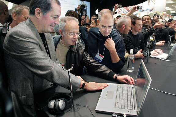 (L-R) Intel CEO Paul Otellini, former Intel CEO Andy Grove and Apple CEO Steve Jobs look at the new MacBook Pro laptop computer at the Macworld Conference and Expo in San Francisco January 10, 2006. The MacBook Pro, which Jobs introduced during his keynote address, uses new two-brained chips from Intel, the first Intel chips to be used in a Mac.  REUTERS/Lou Dematteis  Ran on: 01-14-2006 Intel CEO Paul Otellini, former Intel CEO Andy Grove and Apple CEO Steve Jobs gather 'round the first Intel-chipped Mac.