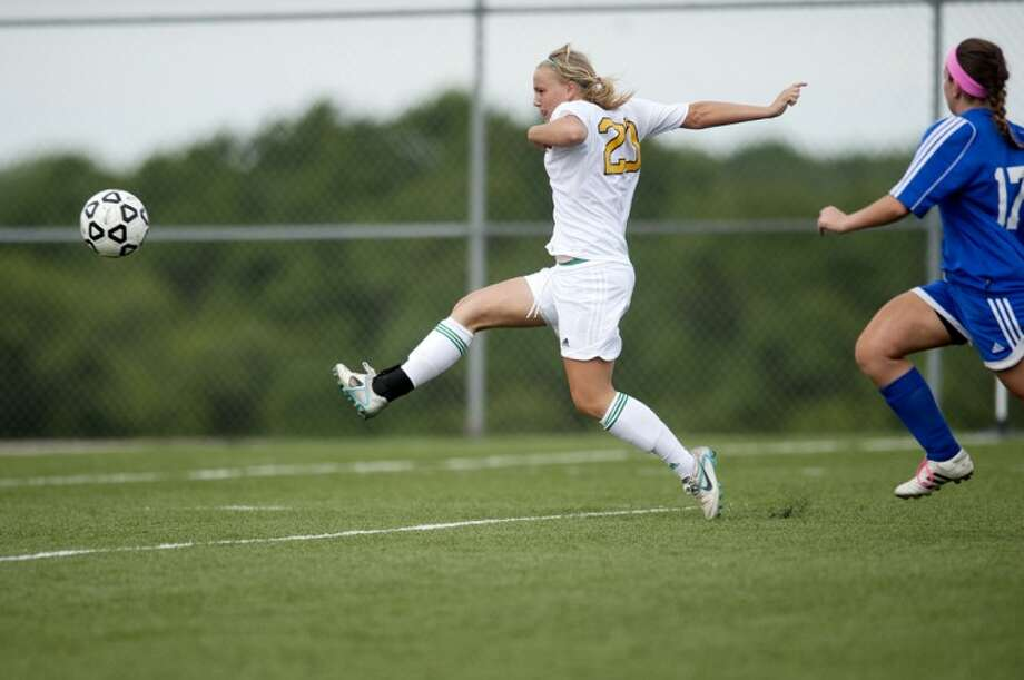 NEIL BLAKE | nblake@mdn.netDow's Rachel Marble scores the third goal against Walled Lake Western at Lake Orion High School on Tuesday. Dow won 3-0. Photo: Neil Blake/Midland  Daily News
