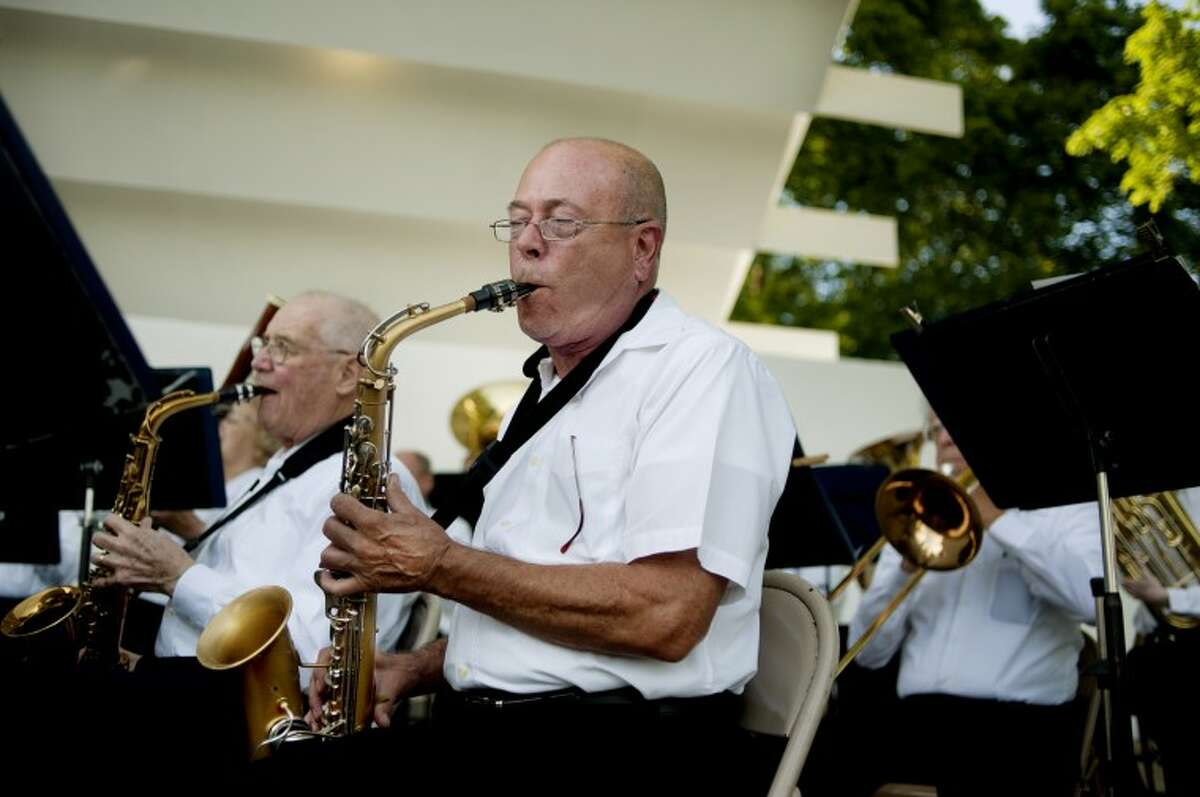 NICK KING   nking@mdn.netChemical City Band alto sax musicians Al Whitted, right, and Bill Crozier perform during the first show of the summer concert series Wednesday at the renovated Band Shell at Central Park.