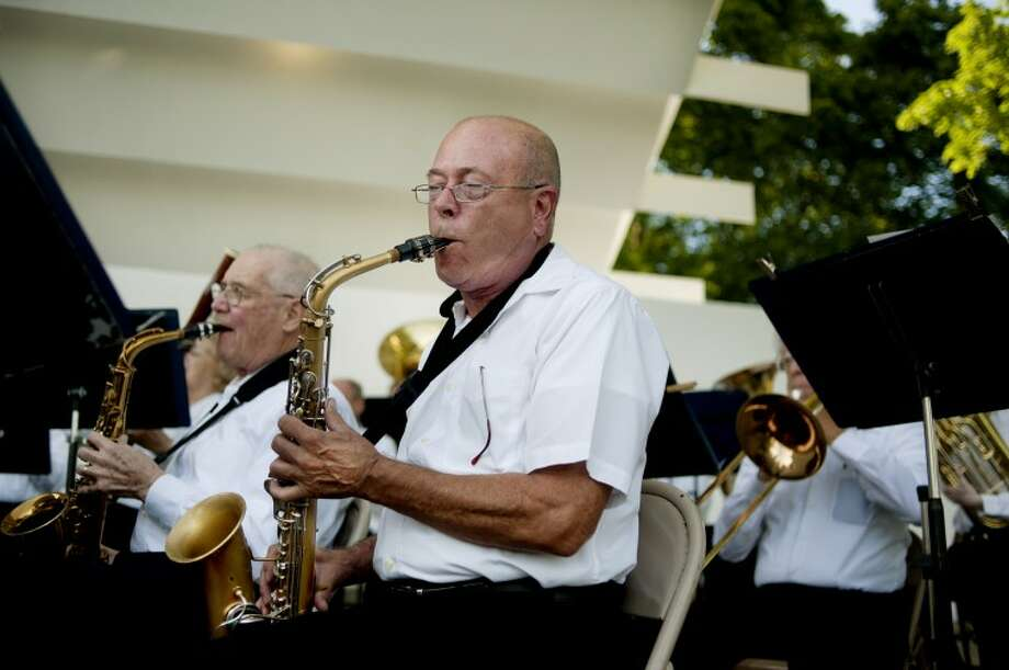 NICK KING | nking@mdn.netChemical City Band alto sax musicians Al Whitted, right, and Bill Crozier perform during the first show of the summer concert series Wednesday at the renovated Band Shell at Central Park. Photo: Nick King/Midland  Daily News