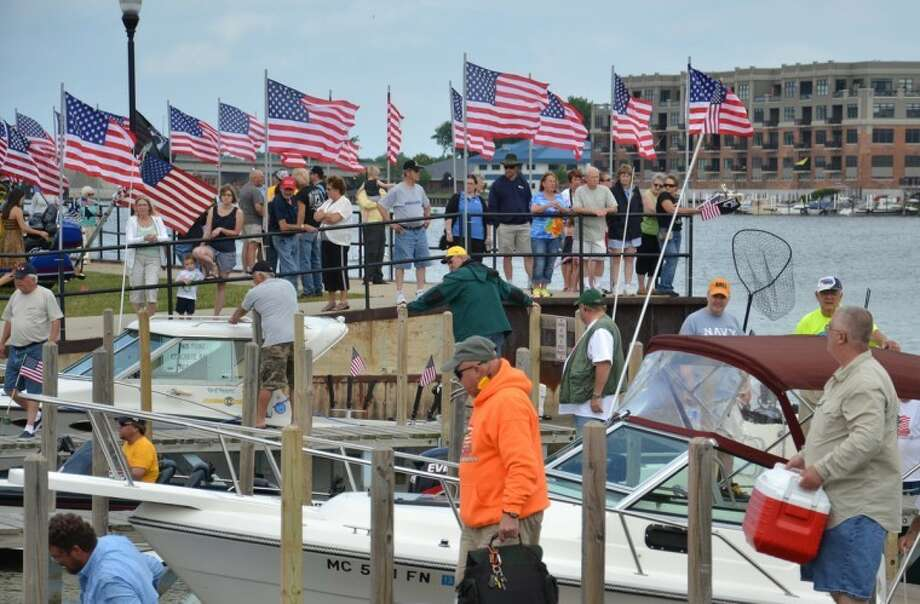 Steve Griffin | for the Daily NewsMilitary veterans and volunteer boat captains and crews return to enthusiastic and grateful welcomes at the Walleyes for Warriors fishing event at Bay City Sunday.