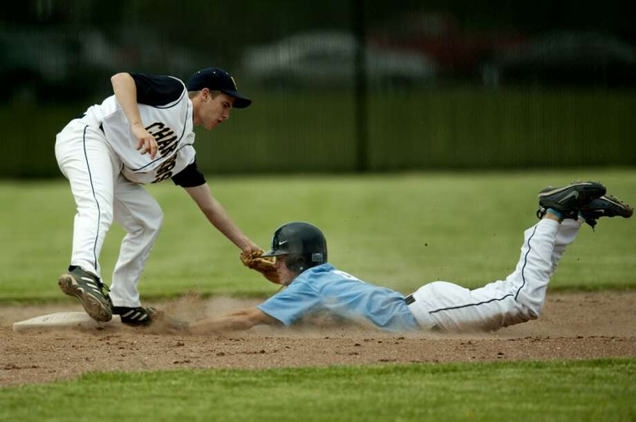 NEIL BLAKE | nblake@mdn.netMeridian's Collin Alexander slides safely into second base under Valley Lutheran's infielder during the district semifinal at Carrollton High School on Monday. Meridian won 4-0. Photo: Neil Blake/Midland  Daily News