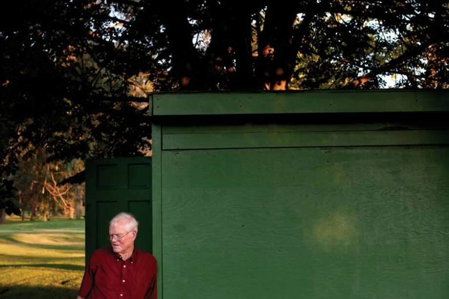 THOMAS SIMONETTI | tsimonetti@mdn.netIn this file photo, Doug Hand leans against a shed near the horseshoe pits at Emerson Park. The pits will be named after Hand, who recently died at the age of 76. Photo: Thomas Simonetti