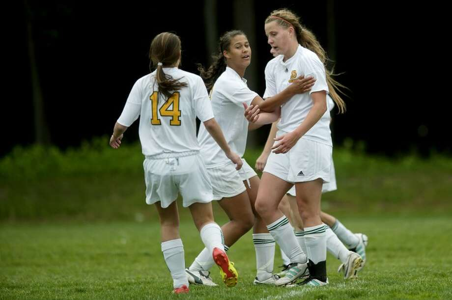 NICK KING | nking@mdn.netDow's Maya Piper, right, celebrates her goal with teammates Michelle Rogowski, left, and Mackenzie Etienne during the second half Thursday at Dow High School. Photo: Nick King/Midland  Daily News