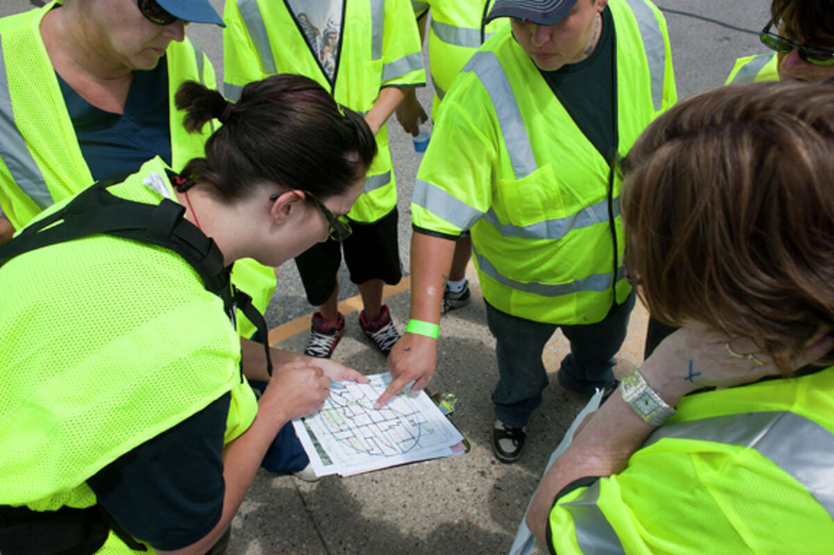 Amanda Oster, left, of Midland County Search and Rescue, goes over a map of the area Friday where she and a group of volunteers will search for Carnel Chamberlain, a missing 4-year-old boy. Volunteers from Isabella County and surrounding communities performed a grid search to try and locate Chamberlain.
