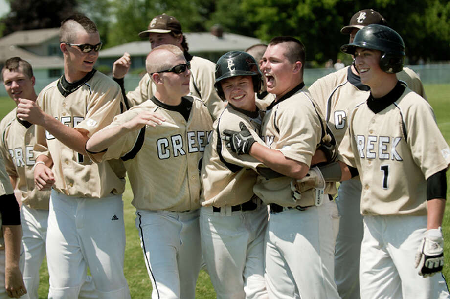 From left, Bullock Creek's Parrish TeaBurgh, Alex Fleming, Steel O'Boyle, Tyler Miller and Jake Dean celebrate after Miller drove in the game-winning run to beat Lapeer East Saturday at John Glenn High School in Bay City. Bullock Creek won the Division 2 baseball regional semifinals game 5-4. Photo: Nick King/Midland  Daily News / Midland Daily News