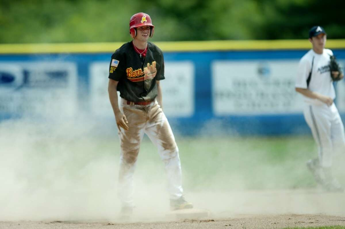 NEIL BLAKE   nblake@mdn.net Midland Berryhill's Adam Fitzgibbon dusts himself off after sliding into second base during the game against Adrian at Gerace Stadium on Friday.