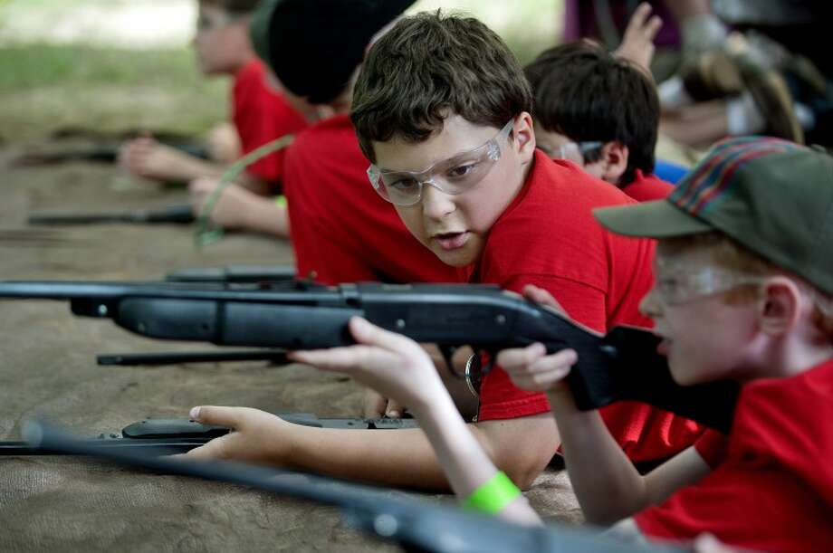 NICK KING | nking@mdn.netLucas Schau, 10, left, talks with friend Jacob Kreamelmeyer, 10, before shooting BB guns during Cub Scout Hero Day Camp on Friday at the Bay City Bowmen property. Lucas has been diagnosed with a bone marrow deficiency and is searching for a donor. Photo: Nick King/Midland  Daily News