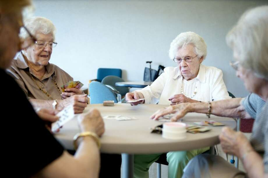 NICK KING | nking@mdn.netKathryn Potts Schlosser, right, plays bridge with her friends, from left, Sophie Milco, Dot Costello and Catherine Horning at Riverside Place. Schlosser, 98, graduated from Midland High School 80 years ago today. Photo: Nick King/Midland  Daily News