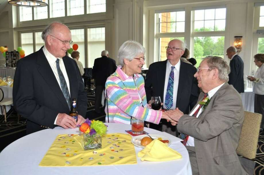Photos courtesy of Robert NelbMidlander E.N. (Ned) Brandt, right, greets guests at his 90th birthday party.