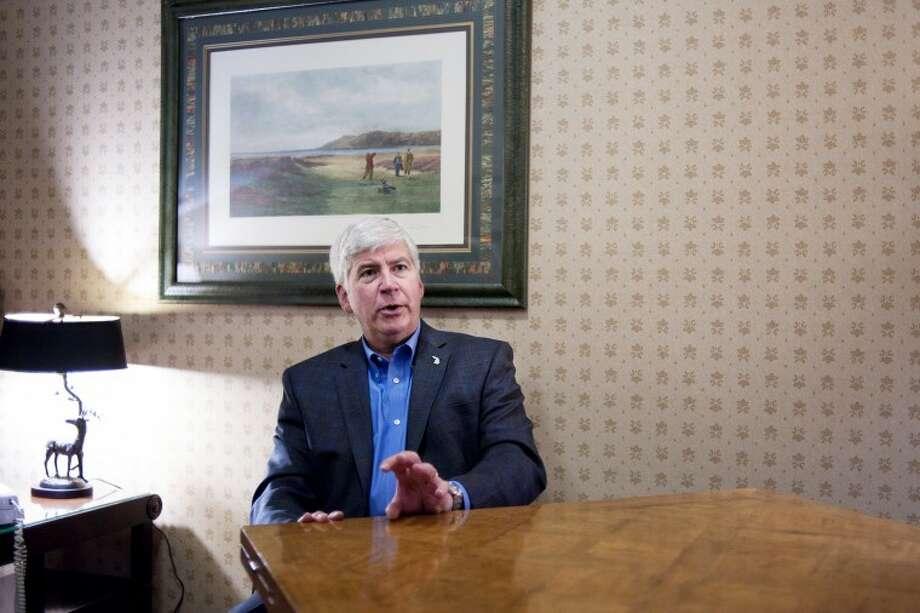 THOMAS SIMONETTI | tsimonetti@mdn.netMichigan Gov. Rick Snyder talks with reporters at Buck's Run Golf Club in Mount Pleasant on Monday. Photo: Thomas Simonetti