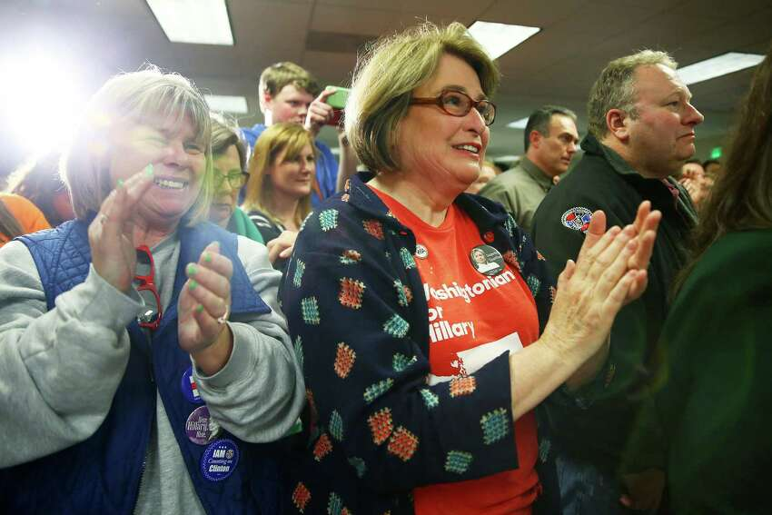 Supporters cheer as presidential candidate Hillary Clinton speaks to a group at the IAM District 751 Everett Union Hall, Tuesday, March 22, 2016.