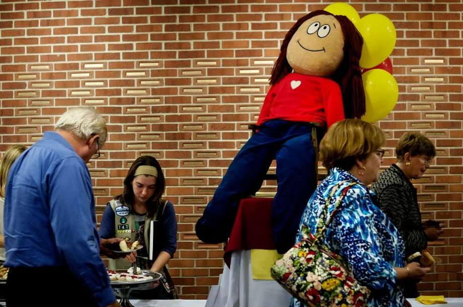 SEAN PROCTOR | for the Daily NewsA stuffed doll of Cathy, the main character in Cathy Guisewite's comic strip, sits on top of a table during the Afterglow reception after Guisewite's talk at the Little Theatre of the Midland Center for the Arts Friday night.
