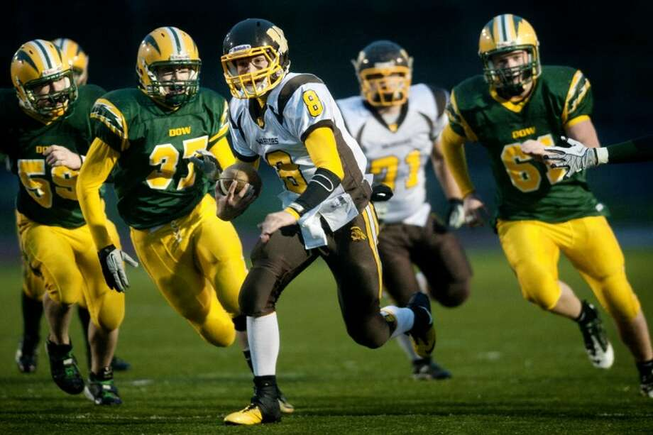 Bay City Western quarterback Austin Pichiotino runs for a touchdown in the second quarter of Friday's Homecoming game at Dow. Photo: THOMAS SIMONETTI | Tsimonetti@mdn.net