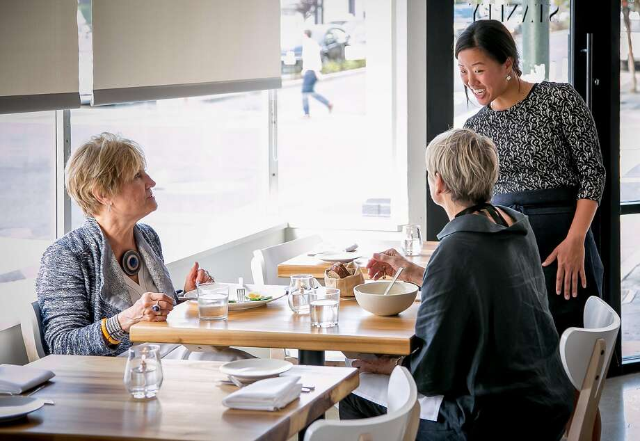 Melanie Raines talks with customers at Lord Stanley in S.F. Photo: John Storey, Special To The Chronicle