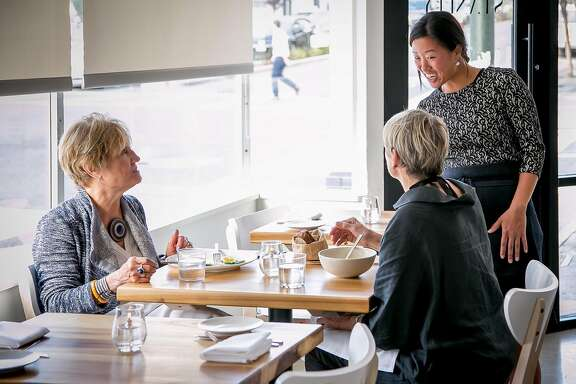 Melanie Raines talks with customers at Lord Stanley in San Francisco, Calif., on July 30th, 2015.