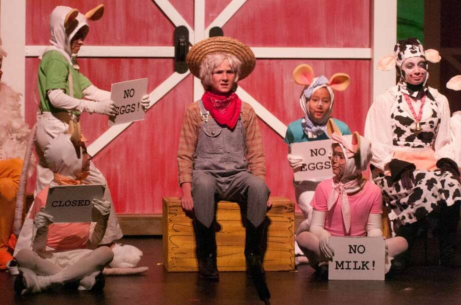 """STEVEN SIMPKINS/Daily NewsTim Hackbarth as Farmer Brown and cast in the Midland Center for the Arts Peanut Gallery production of """"CLICK, CLACK, MOO: Cows That Type."""""""