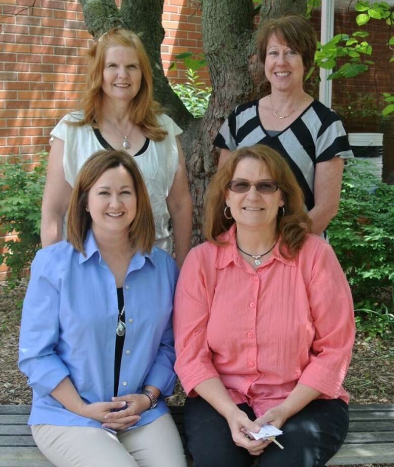 Photo providedSiebert Elementary School first grade teachers Penny Church and Elizabeth Daniels (seated) and Iris Archbold and Michelle Sczepanski work as a team to help their students shine.