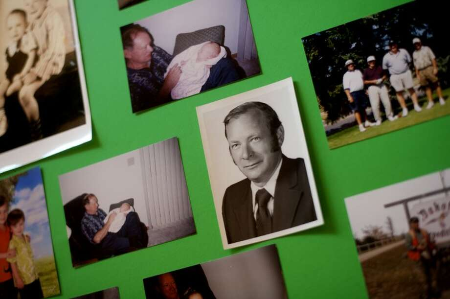 NICK KING | nking@mdn.net A poster board on display is covered with family photos of Doctor Richard Nowak during his retirement party Wednesday at the Whiting Forest Visitor Center in Midland. Photo: Nick King/Midland  Daily News