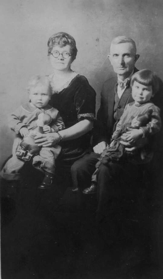 Ella and James Hayden posed for a photo with their first two grandchildren, Altheda and R.J. Hayden's sons. James is sitting on his grandma's lap and Junior is sitting on his grandpa's lap. Junior (Harvey James) died at the age of four in 1928, a year before Tom was born.