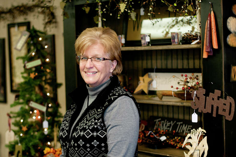 Connie Bradley owns Country Blessings with her husband Doug. Country Blessings moved from their store in Freeland to Midland and have been open at 503 S. Saginaw Road for about a month. Photo: NICK KING | Nking@mdn.net  / Midland Daily News