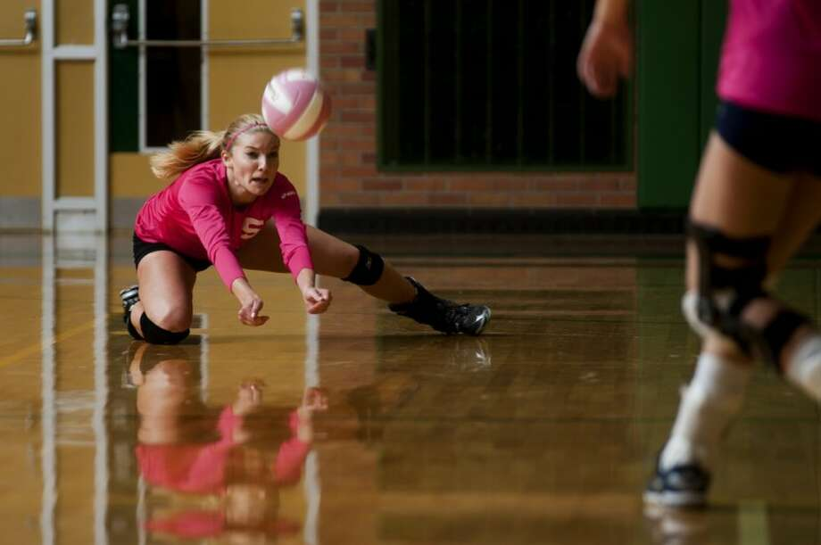 NEIL BLAKE | nblake@mdn.netH.H. Dow's Emilee Voet dives for the ball during Tuesday's game against Mount Pleasant at H.H. Dow High School.