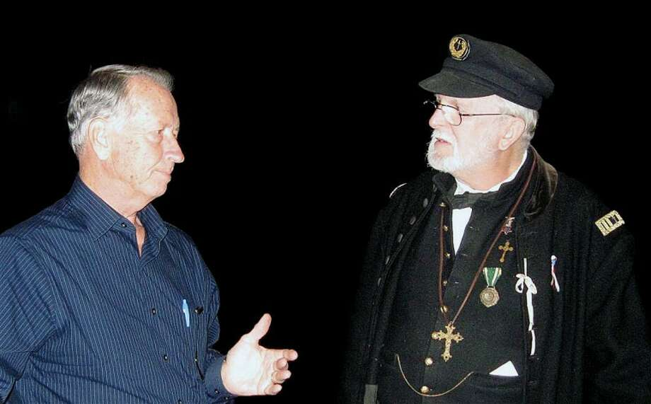 STUART FROHM for the Daily NewsThe Rev. Rich Campbell of Coleman, wearing a reproduction of a Union Army chaplain's uniform, talks with Al Eicher of Bloomfield Hills after Eicher and his son, David Eicher, presented a program on Michigan in the Civil War.