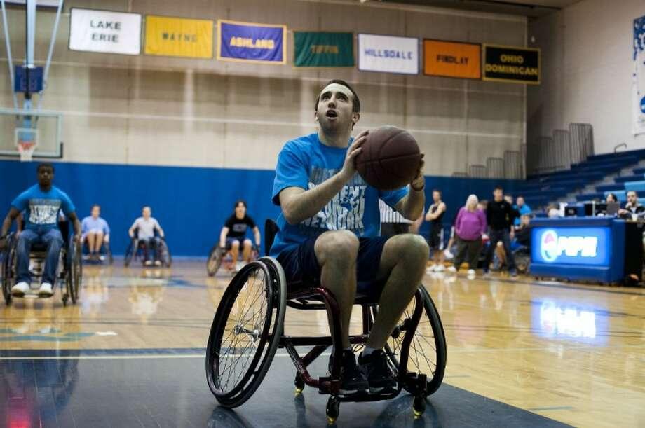 NEIL BLAKE | nblake@mdn.net Photo: Neil Blake/Midland  Daily News