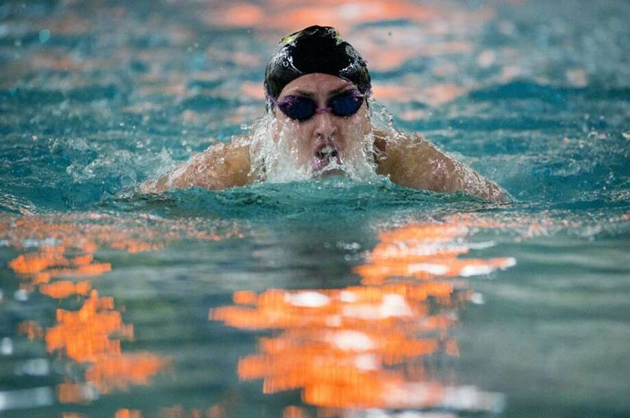 Dow High's Kara Dean competes in the breaststroke leg of the 200 yard individual medley Saturday during the Tri-Cities Swimming and Diving Championships hosted by Midland High at the Dow High pool. Photo: SEAN PROCTOR | For The Daily News