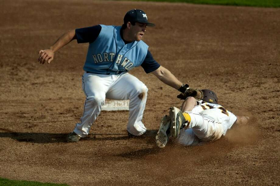 NEIL BLAKE | nblake@mdn.netNorthwood's Jason Fracassa tags out Central Michigan's Nick Regnier on Tuesday at Theunissen Stadium in Mount Pleasant. Northwood lost 4-3. Photo: Neil Blake/Midland  Daily News