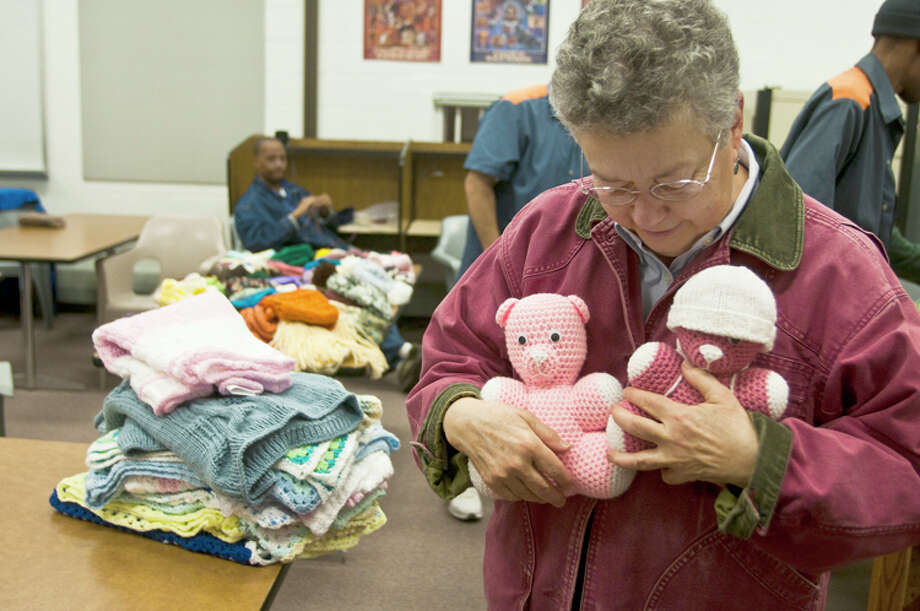 AP Photo | The Bay City Times, Lathan GoumaBarbara Fisher holds two teddy bears that were crocheted by inmates at the Saginaw Correctional Facility in Freeland,. Fisher volunteers at the correctional facility to help teach the inmates knitting and crocheting techniques. Photo: Lathan Goumas / The Bay City Times