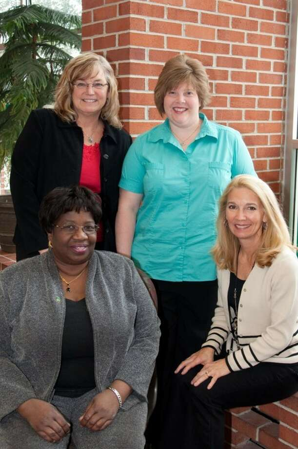 Photo providedThe Service-Learning Team at Delta College team includes, clockwise from back left, Karen Wilson, professor of economics; Michelle White, manager of academic, career and experiential learning, Nancy Vader-McCormick, coordinator of the Faculty Center for Teaching Excellence; and Teresa Stitt, associate dean of community development.
