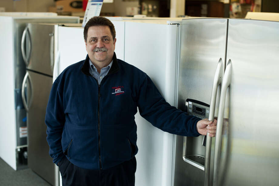 NEIL BLAKE | nblake@mdn.netHenry Schumann of Bay City is one of the salesmen at Millar's Appliance in Bay City.