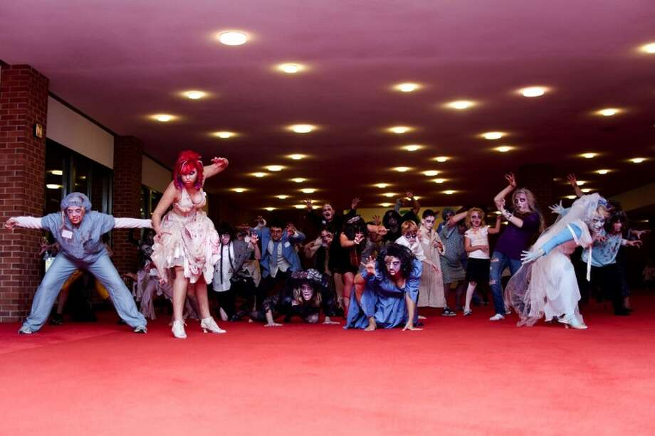 """A group of 41 locals of all ages gathered together in zombie costumes and makeup to perform the famous dance to Michael Jackson's """"Thriller"""" Saturday morning at Midland Center for the Arts. The group, led by Marci Rogers of Midland, danced as part of """"Thrill the World,"""" a movement that encourages people worldwide to gather and simultaneously perform the dance in an attempt to set a world record for numbers of participants. This year was the first since 2007 for Rogers to be back in the area and able to gather a group together to perform. Photo: SARA WINKLER   For The Daily News"""