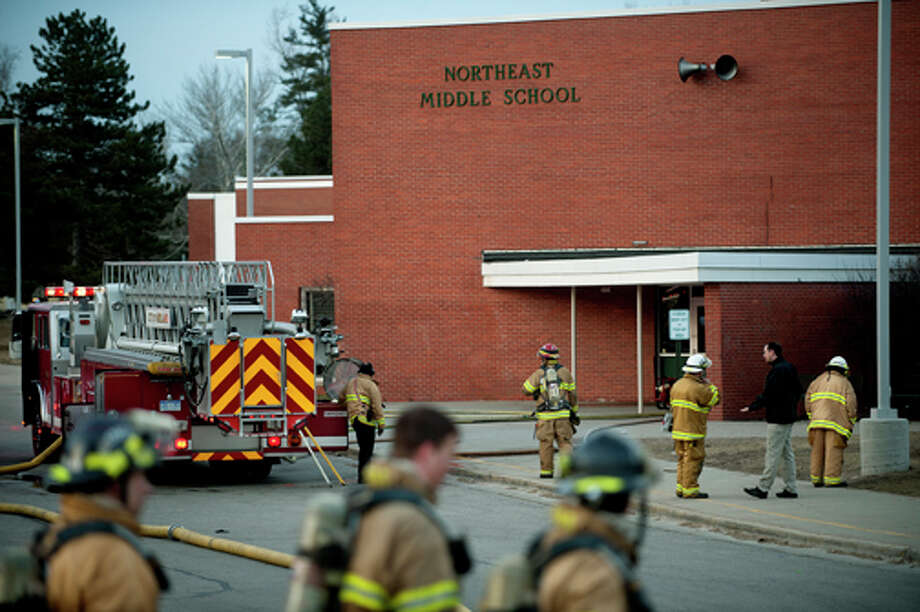 NICK KING | nking@mdn.net Midland firefighters work the scene of a fire at Northeast Middle School on Wednesday morning. Photo: Nick King/Midland  Daily News / Midland Daily News