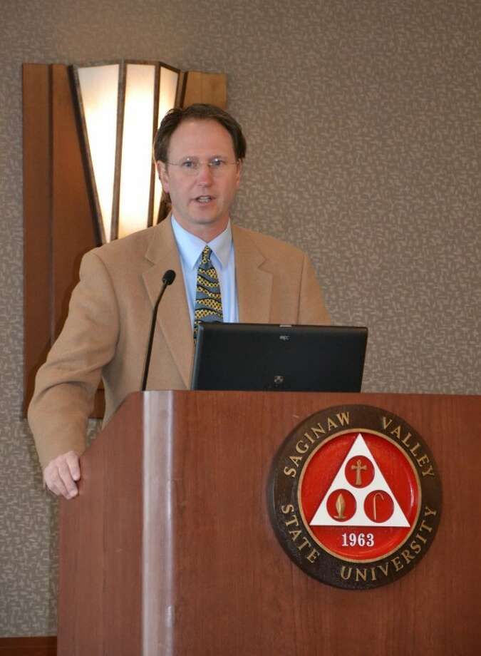 Steve Griffin | for the Daily NewsCameron Davis, senior adviser to U.S. Environmental Protection Administrator Lisa P. Jackson, delivers the keynote address to the 2012 Saginaw Bay Watershed Conference.