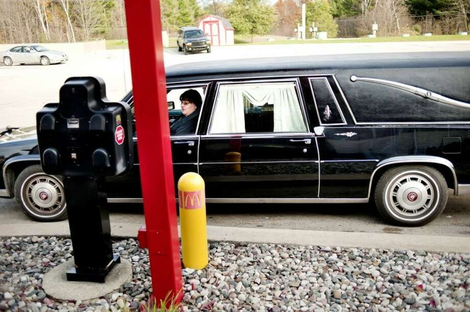 NICK KING | nking@mdn.netWhile in her hearse, Dawn Lueders orders from the Sanford McDonald's drive-through on Friday. Lueders drives the spooky car around town during the fall months. Lueders bought the car from a horror author in Pennsylvania.