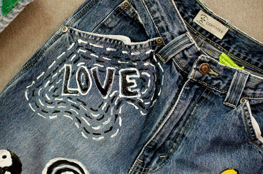 "Local students decorated the jeans on display on the second floor of the Grace A. Dow Memorial Library in honor of Denim Day. The jeans were decorated along the theme of ""Respect in Relationships."" Photo: NEIL BLAKE 