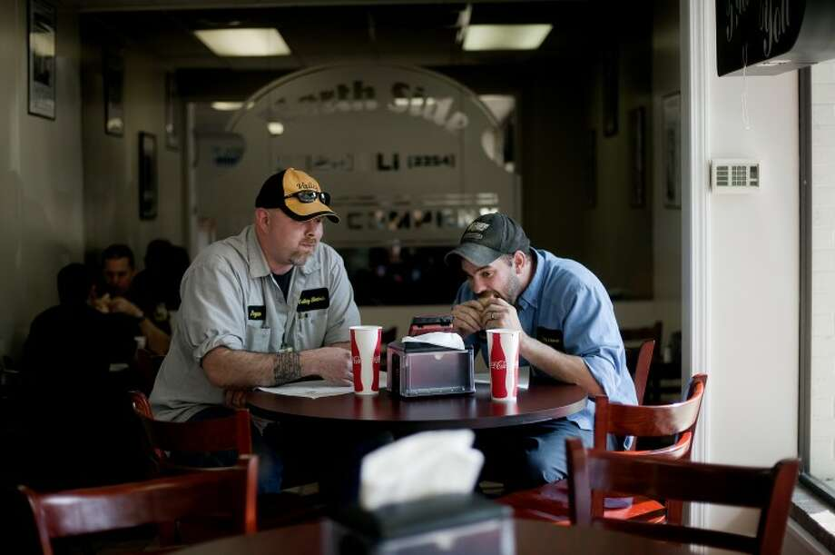 NICK KING | nking@mdn.netBryan Dewitt, left, and Randy Harrell eat lunch at North Side Deli in Midland. Photo: Nick King/Midland  Daily News