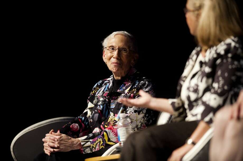 "Margaret Riecker, president of the Herbert H. and Grace A. Dow Foundation, left, listens as Dr. Ruth Shaw, right, fields a question from the audience during a panel discussion entitled ""VOICES: Women in Leadership,"" at the Midland Center for the Arts on Tuesday. The women, along with Kathleen Wilbur and Anne Doyle, told their personal stories and spoke about the history and future of women taking on leadership roles. Photo: NEIL BLAKE 