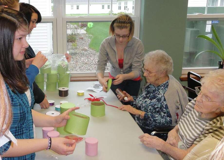 Photo providedThe students work on crafts with Brook Retirement residents.