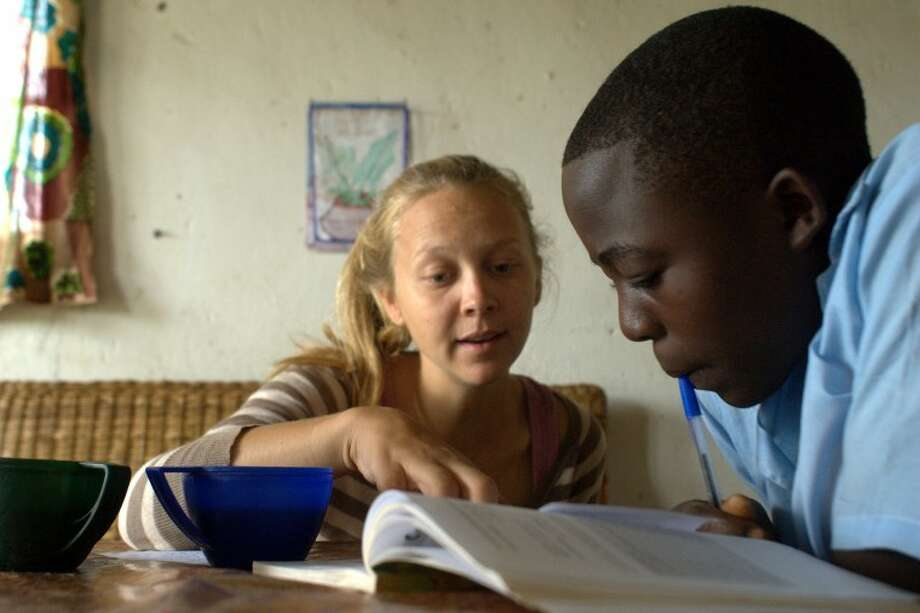 "Photo by Brianna ScrogginsAlyssa Morley helps Wongani Kayila, 18, from Muhana village, study for an exam on April 3. Morley has returned to Midland after being an education Peace Corps volunteer from the country known as the ""Warm Heart of Africa,"" Malawi. Photo: Briana Scroggins"