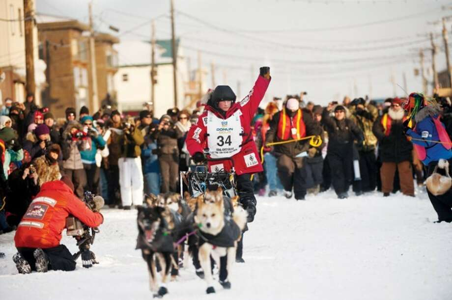AP Photo | Marc Lester, Anchorage Daily NewsDallas Seavey reaches the finish line to claim victory in the Iditarod Trail Sled Dog Race in Nome, Alaska on March 13. At age 25, Seavey is the youngest musher to win race. His father, Mitch Seavey, is also an Iditarod champion. Photo: Marc Lester