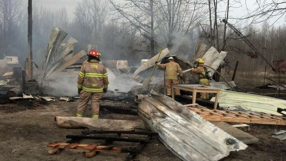 Photo by Ralph E. WirtzFirefighters at the fire scene in Greendale Township.