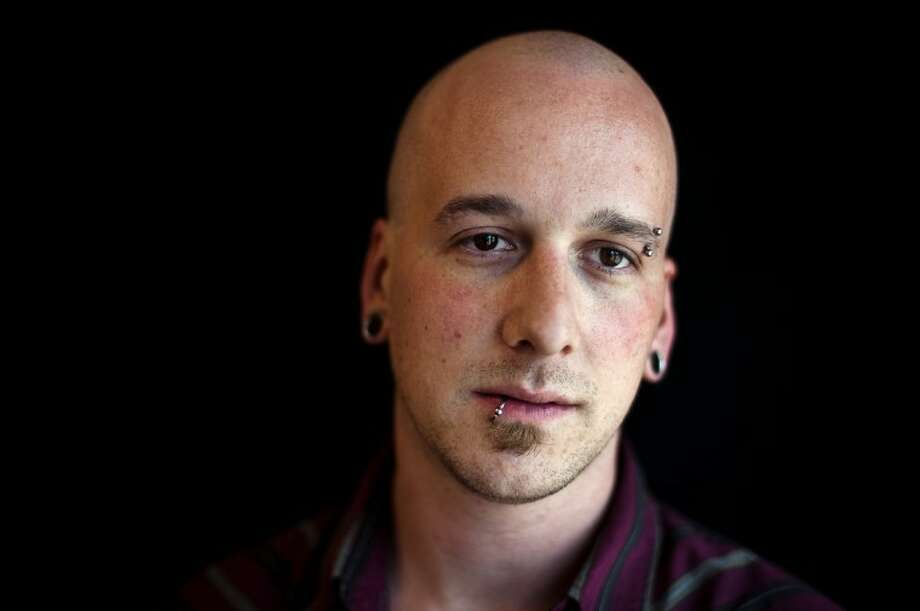 Jordan Grakauskas, owner of American Revolution Tattoo, is attempting to get the message out that tattoo parties in private homes can be dangerous. The practice is against the law and can lead to complications and disease. Photo: NEIL BLAKE | Nblake@mdn.net