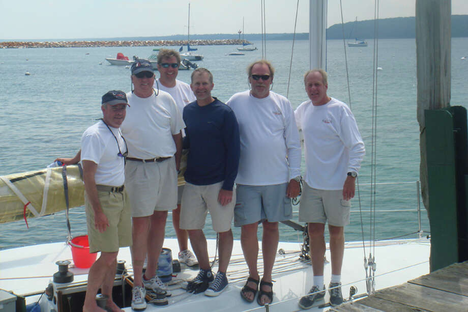 Photo courtesy of Laurie Smith TudorThis photo shows crew members on WingNuts for the 101st Chicago to Mackinac Sailboat Race two years ago. Included in the picture are (left to right) John Dent, Rob Rye, Peter Morley Jr., Lee Purcell, Mark Morley and Stan Dent. Mark Morley of Saginaw was one of two people who died when the sailboat capsized in this year's race.