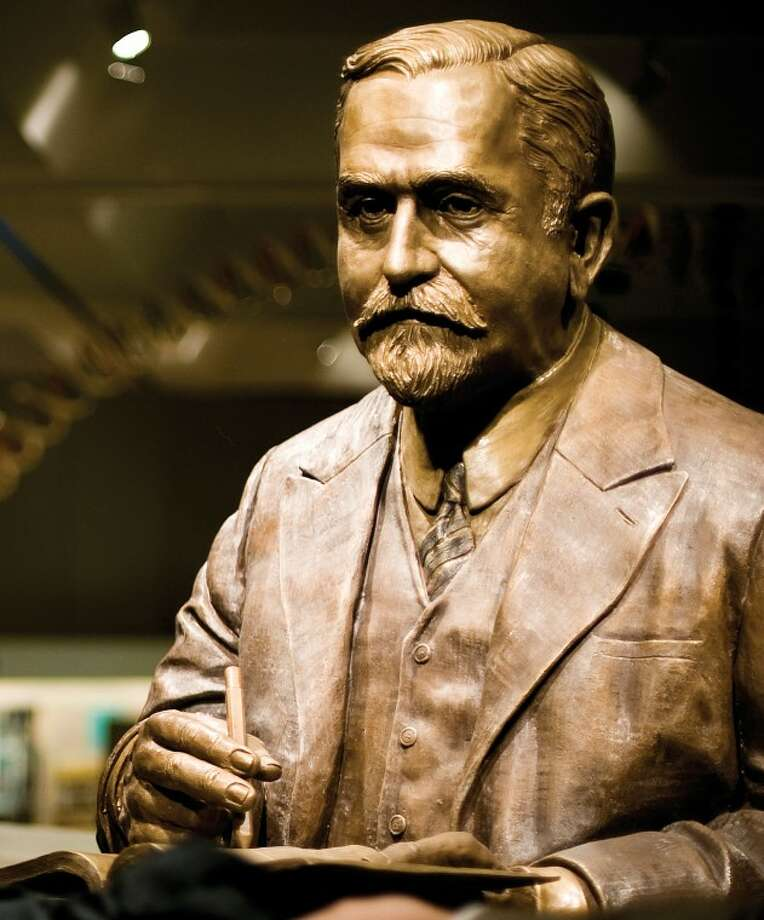 "A statue of Herbert H. Dow, titled ""The Inventor,"" is shown in this file photo. The sculpture will be placed at the Dow Founder's Garden. Photo: Nathan Morgan"