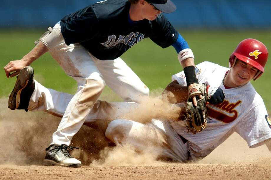 Midland Beryhill's Josh Bailey slides safely into second base in the fourth inning as his team defeated the Michigan Dawgs 5-4 for the Gabby Mills July 4th Invitational Thomas Adams Bracket championship at Northwood University. Photo: THOMAS SIMONETTI | Tsimonetti@mdn.net