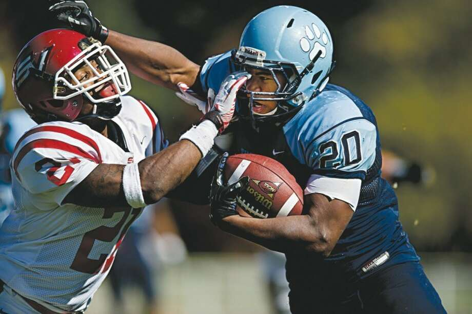 NEIL BLAKE | nblake@mdn.netNorthwood fullback Cameron Jackson fights to stay inbounds as Saginaw Valley defensive back Jon Bryant shoves him out at Hantz Stadium on Saturday. Photo: Neil Blake/Midland  Daily News